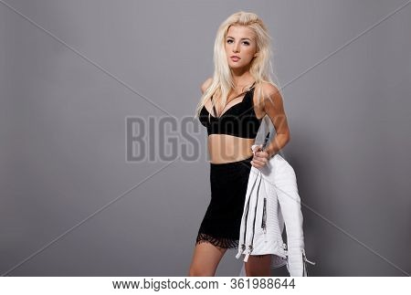 Sexy Blonde Young Woman Posing With Atittude Wear In Black Bra, White Jacket, Smoking Vape Isolated