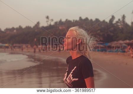 Beautiful Profile Portrait Young White Skined Woman With Beach Background. Northernmost Beach Of Bar