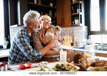 Happy Grandchildrens Girls Having Breakfast With Her Grandparents
