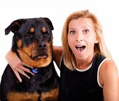 Self portrait of a blonde woman with an excited expression and her dog who is not so excited. poster