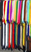 multicolored new laces hanging in row on sale poster