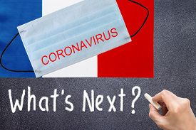 Flag Of France With Disposable Mask And Coronavirus Inscription. Global Covid-19 Coronavirus Pandemi