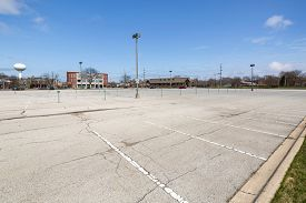 A suburban train station commuter parking lot is virtually empty during a business day because of the COVID-19 pandemic.