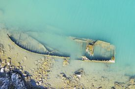 An Aerial View Of The Sinking German Ship Fritz From World War Ii In The Bay Of Salamustica In The R
