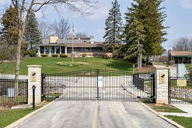 PALATINE, IL - APRIL 7, 2020: On a sunny spring day, a suburban golf course remains closed because of the quarantine, social distancing and home isolation guidelines during the coronavirus pandemic.