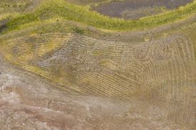 Aerial View Of Unusual Markings In The Ground Near A Water Reservoir