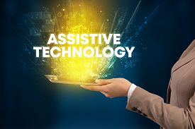 Close-up of a touchscreen with ASSISTIVE TECHNOLOGY inscription, innovative technology concept