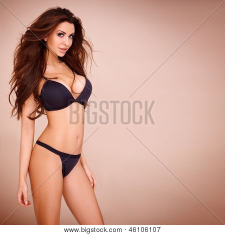 Sexy pose of a dark haired woman wearing a black bikini poster
