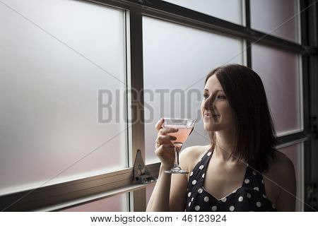 Beautiful Young Woman Drinking A Pink Martini