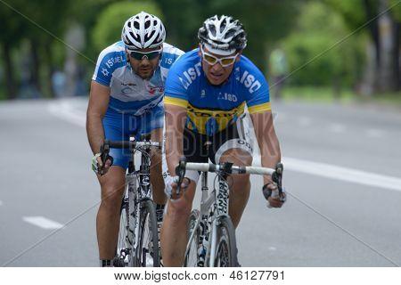 KIEV, UKRAINE - MAY 24: Sergey Krasnov, Ukraine (in front) and Tai Gabay, Israel in the bicycle racing Race Horizon Park in Kiev, Ukraine on May 24, 2013