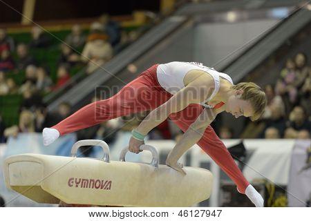 KIEV, UKRAINE - MARCH 31: Artem Bykov, Belarus performs exercise on pommel horse during International Tournament in Artistic Gymnastics Stella Zakharova Cup in Kiev, Ukraine on March 31, 2013