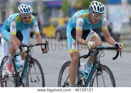 KIEV, UKRAINE - MAY 24: Sergey Renev (first) and Alexander Shushemoin, Kazakhstan in the bicycle racing Race Horizon Park in Kiev, Ukraine on May 24, 2013