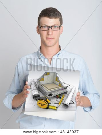 Young man holding a sign with a technical architecture rendering