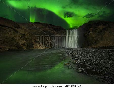 Flash Of Aurora Polaris Above Waterfall
