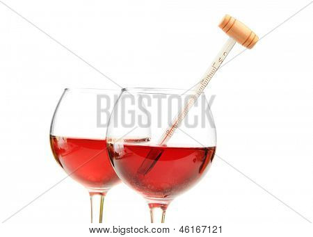 Glasses of wine with thermometer, isolated on white