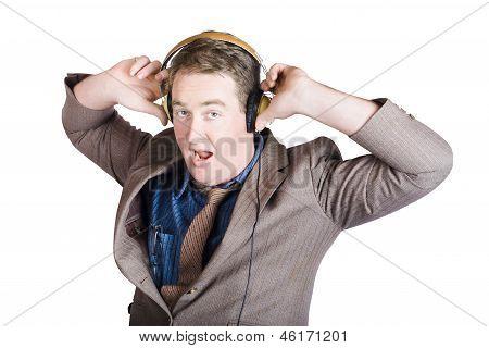 Funny Businessman Wearing Earphones On White