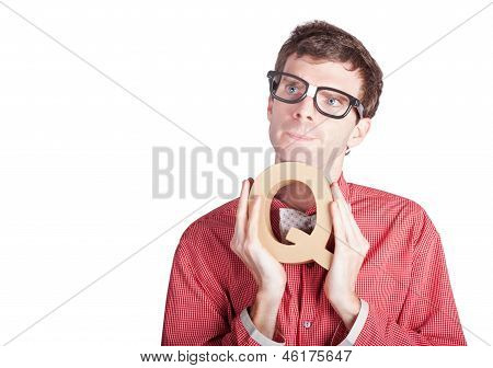 Businessman Holding Q For Question
