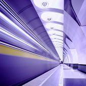 Violet train on platform in subway in violet poster