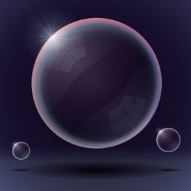 Soap bubble on a black and blue background - transparent glossy bubble on air