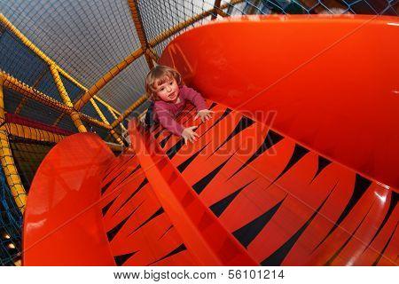 Little girl on a big slide