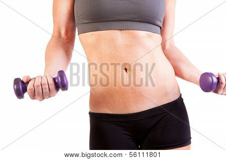 A woman's belly shot working out with weights