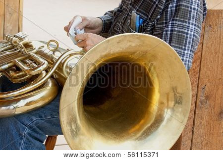 Man Cleaning Tuba