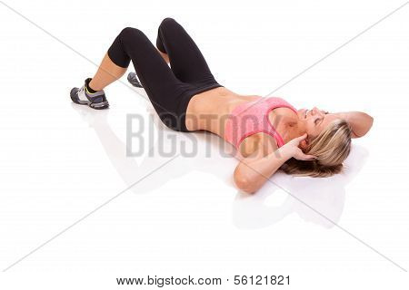 Portrait of pretty young woman doing a situp exercise