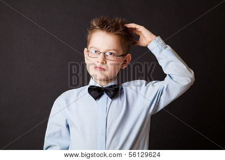 Boy  scratching his head thinking