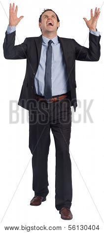 Stressed businessman gesturing on white background