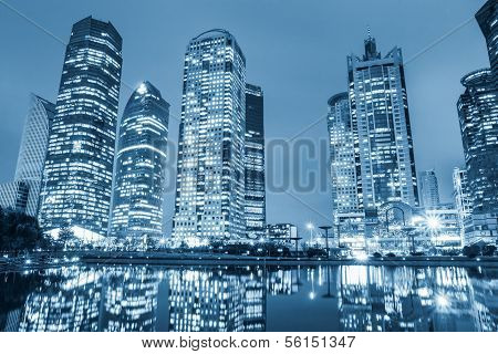 Night View Of Modern Architecture And Reflection