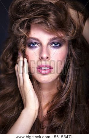 Portrait Of A Young Sexy Woman With A Mass Of Long Hair