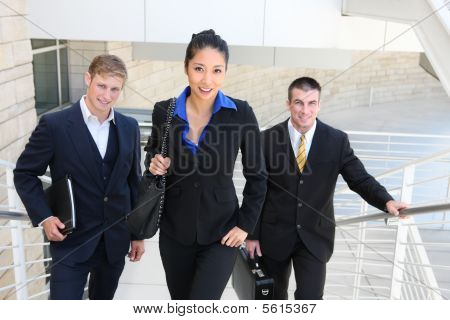Business Team Walking Up Stairs