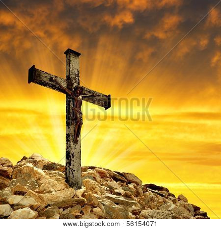 Jesus Christ on The Cross in the sunset