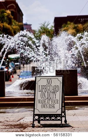 Fountain With A Warning Sign