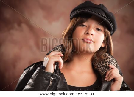 Pretty Hispanic Girl with Hat and Leather Jacket Studio Portrait. poster