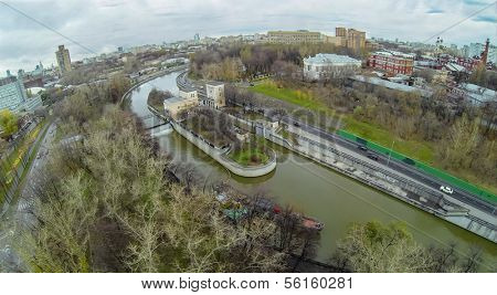 Yauza river with two sluices of Syromyatnicheskiy waterworks against the cityscape, view from unmanned quadrocopter.
