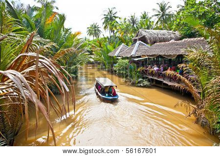 BEN TRE, VIETNAM-NOV 18, 2013: A famous tourist destination is  Ben Tre village on Nov 18, 2013. in Mekong delta , Vietnam. Mekong Delta is home of people who live along the many channels.