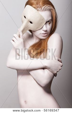 Burlesque. Naked Styled Woman Colored White With Venetian Mask