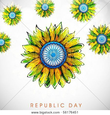 Happy Indian Republic Day concept with beautiful floral design decorated with peacock feathers and Ashoka Wheel on grey background.