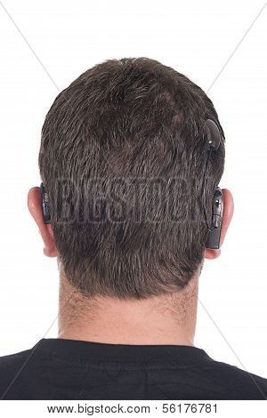 Young Deaf Or Hearing Impaired Man With Cochlear Implant And Hearing Aid