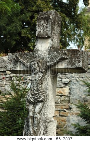 Old Catholic Cross On The Churchyard