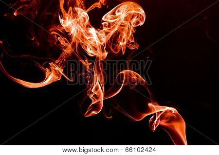 Red smoke on a black background.