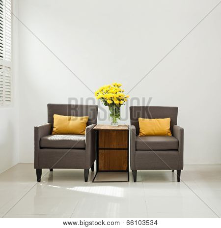 Grey Sofa Armchair In Simple Setting