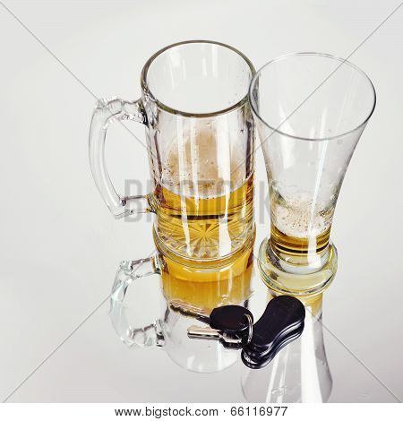 Drunk Driving Beer Glasses With Keys On White