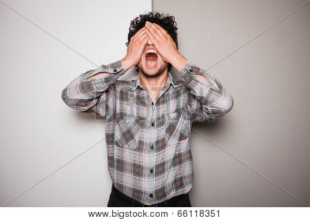 Upset Young Man Against Dual Colored Background