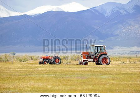 Tractors on farm in the western USA