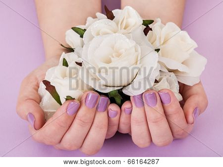 Close-up Of Hands Holding White Roses