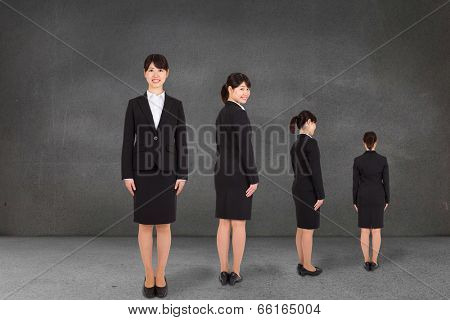 Composite image of multiple image of businesswoman against grey room