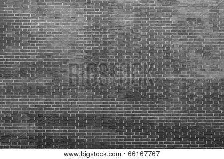 texture of an old bricklaying in dark black tones for abstract backgrounds and for wallpaper poster