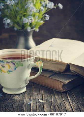 Cup Of Tea, Vintage Books And  Summer Blue Flowers On The Table.